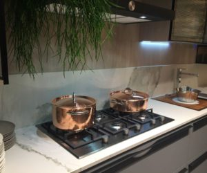 Copper pots and marble backsplash