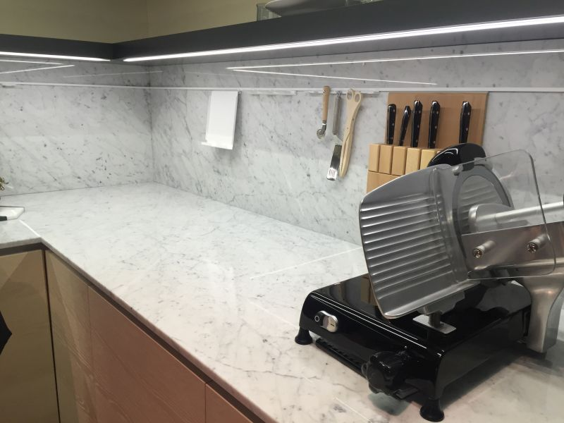 Corner kitchen with marble on backsplash and countertop