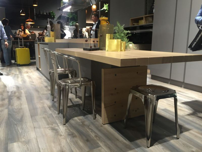 Floating kitchen island extension and stainless steel chairs