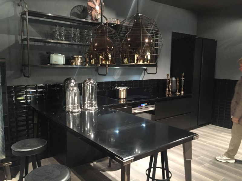 Industrial kitchen island design and black subway tiles