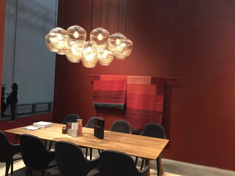 Lighting fixture over rectangular dining table