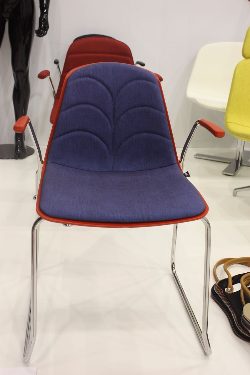 This Luxy design would also be appropriate as a dining chair. The sculpted design in the back and the contrast of two colors, along with the minimal arms, make it a very interesting chair.