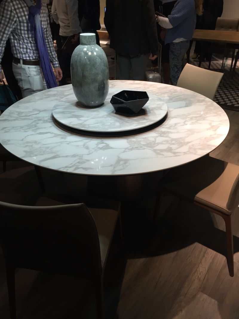 Marble dining table with a lazy susan system