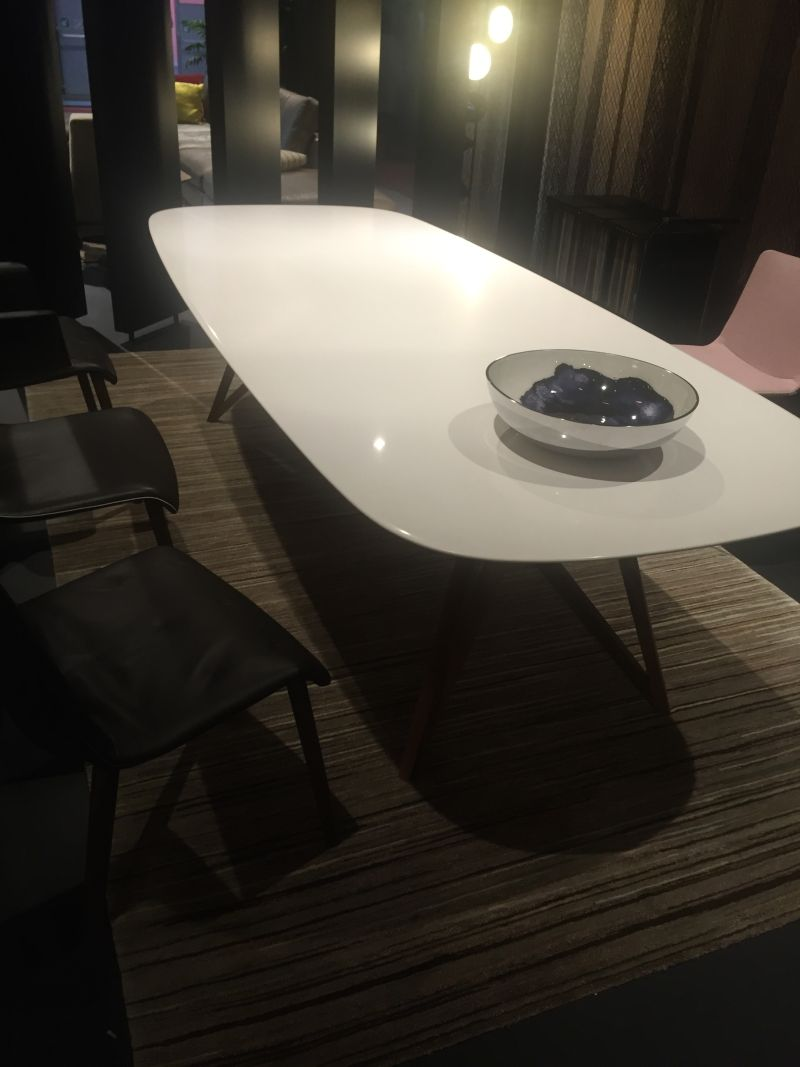 Oval white dining table with dark legs