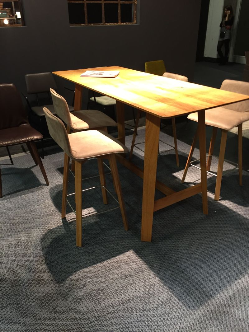 Standing table with stools