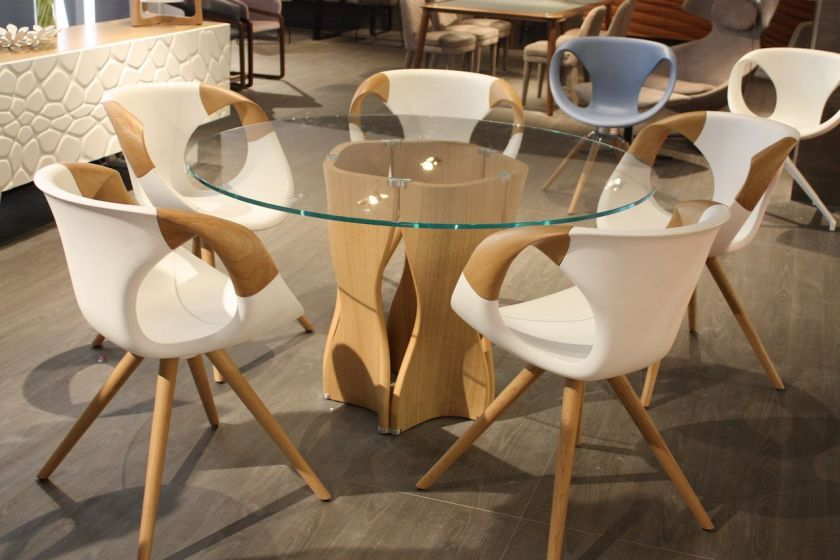 While the base of this dining table is beautiful the dining chairs in this set by Tonon are the real stars of the set. The Up-chair, a bestseller created in 2012 has been updated. The shell in the technical soft touch material has solid wood armrests in American walnut.