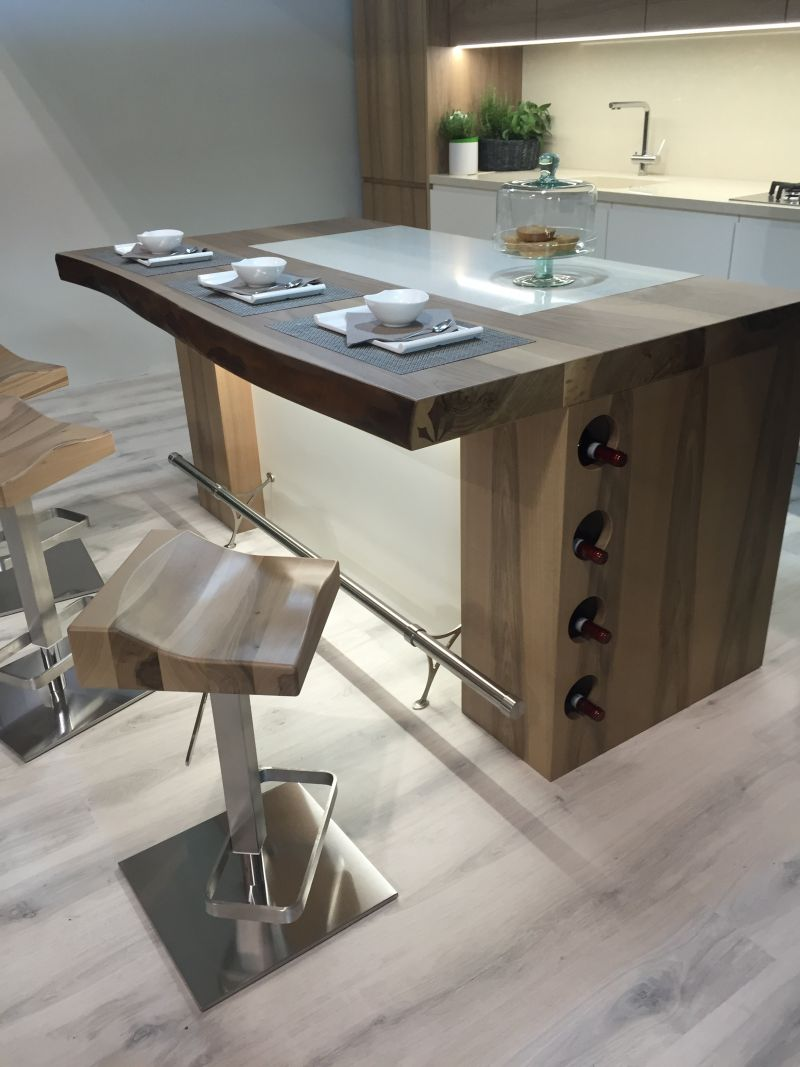 Wood contertop kitchen island and wine bottle storage