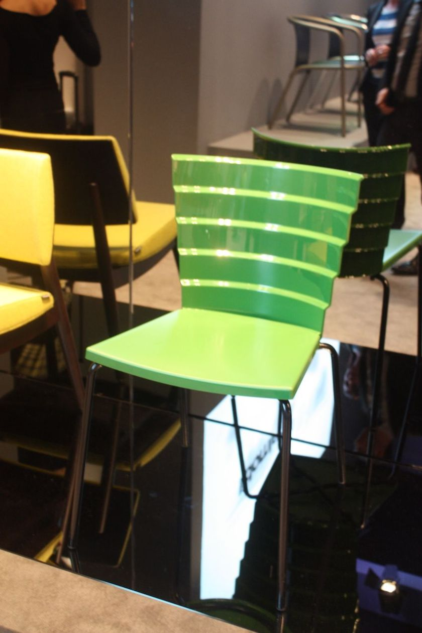 Metalmobil's Bikini Chair is fun and funky, and can be used as an indoor and outdoor dining chair. The tiered design of the back makes it stand out, and it would be appropriate in a wide variety of design settings.