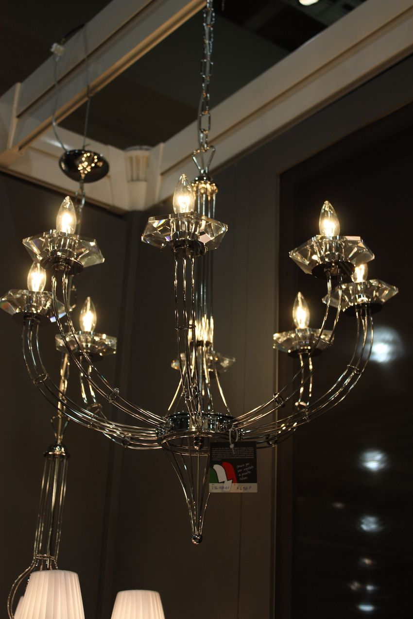 Italian lighting company Metal Lux creates artful designs from glass. This traditionally shaped glass chandelier has sleek curves like slowly flowing water.