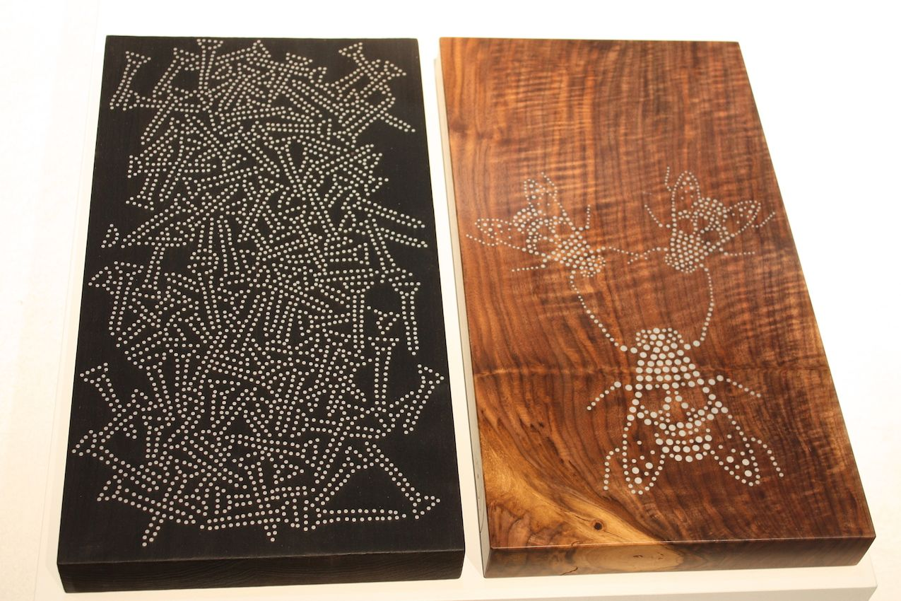 Two different designs on various woods.