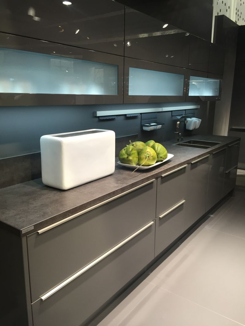 Gray kitchen design with glass cupboard doors