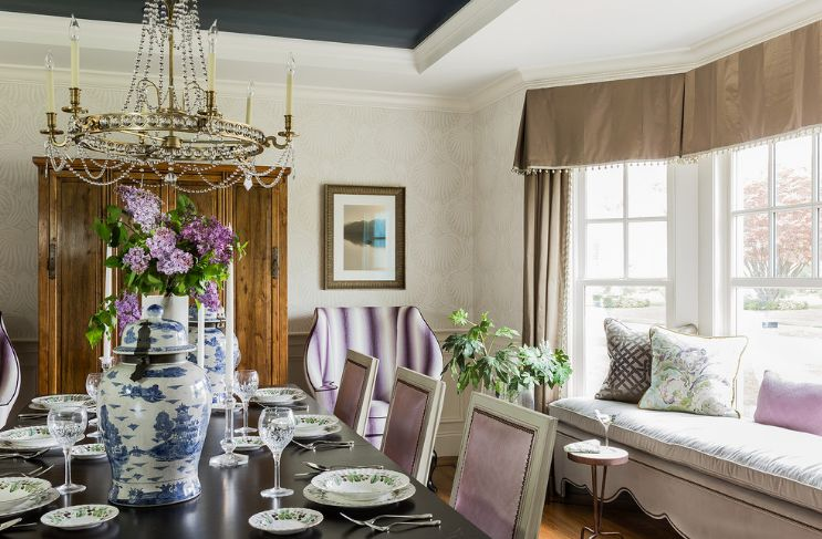 Levender dining room accents with big chandelier over table
