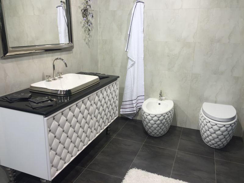 Luxury black and white tufted bathroom vanity and toilet
