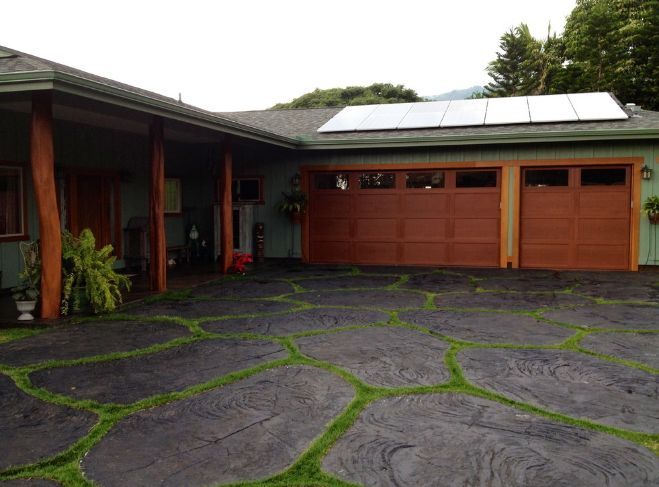 Paved driveway with grass border
