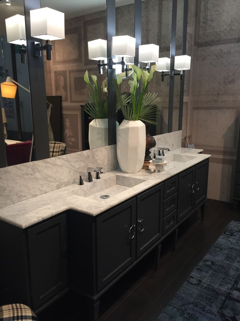 Traditional bathroom design vanity with marble on top and dark vanity