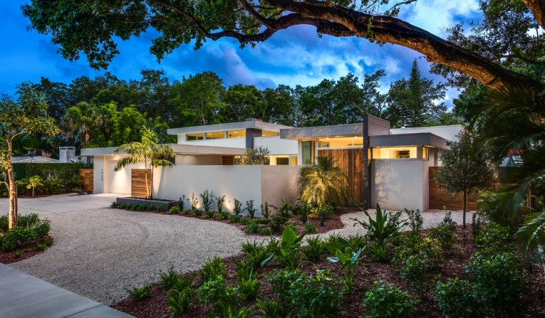 Tropical house exterior with gravel driveway