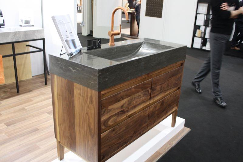 Unk Stone bathroom sink and reclaimed wood vanity