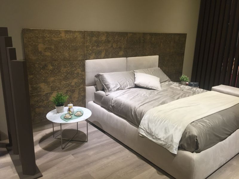 White bed for a copper wall headboard