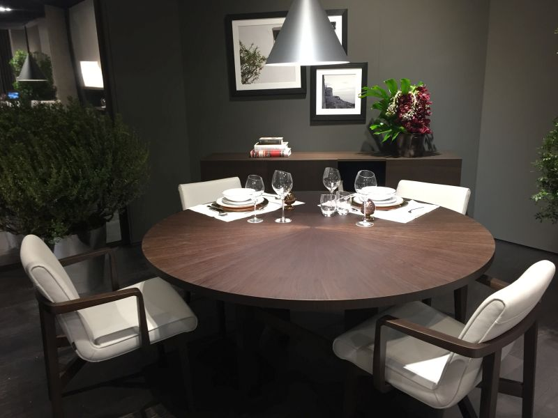 Round Wenge dining table with white chairs