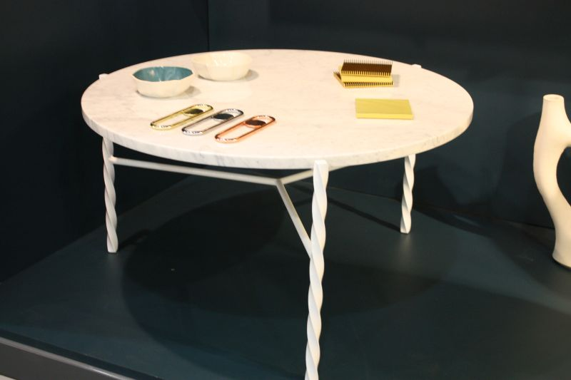 White dining table with an interesting base