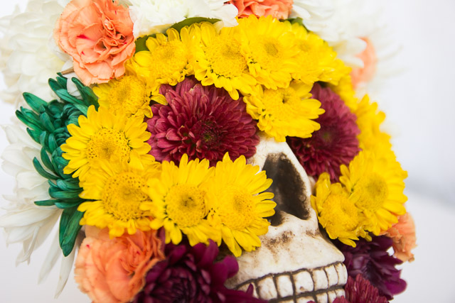 Dead flowers on skeleton skull