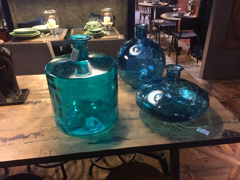 Empty blue glass jars and vases