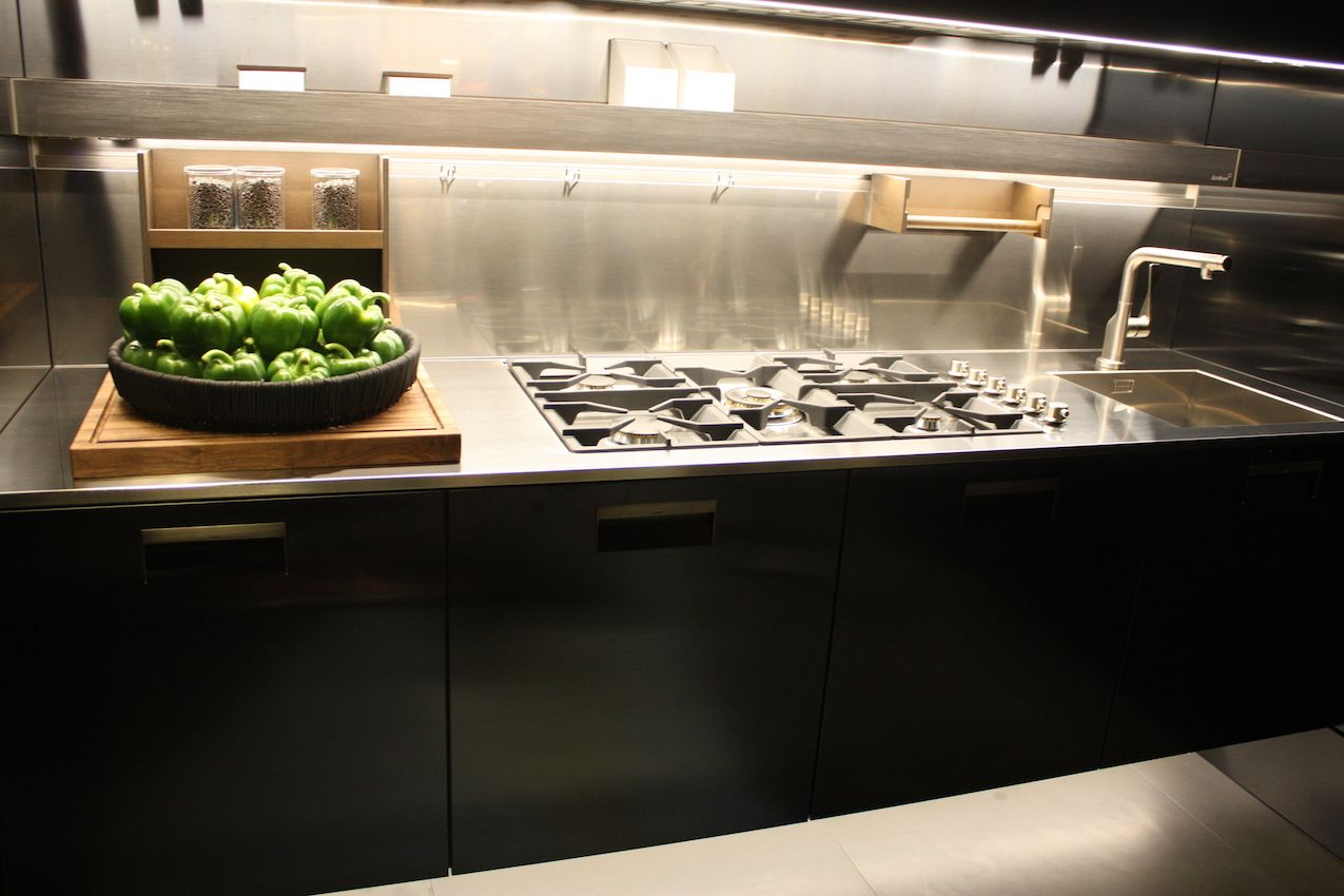 Arclinea's counter with cooktop and sink has lots of functional extras.