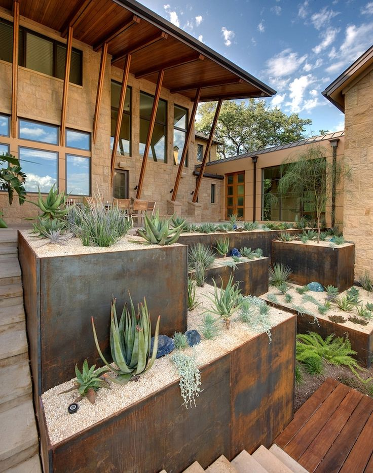 Elevated corten steel planters for backyard
