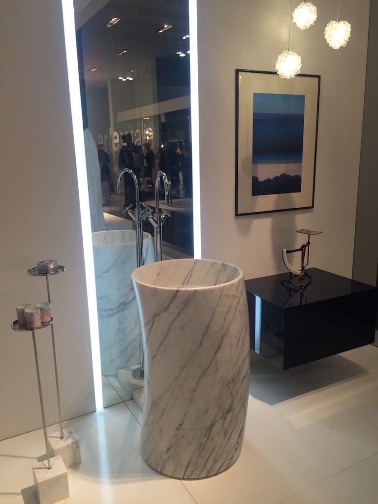 This marble pedestal sink is a modern addition.
