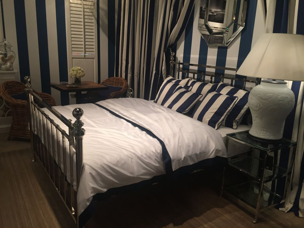 Nautical bedroom color theme with mirrored bed and furniture