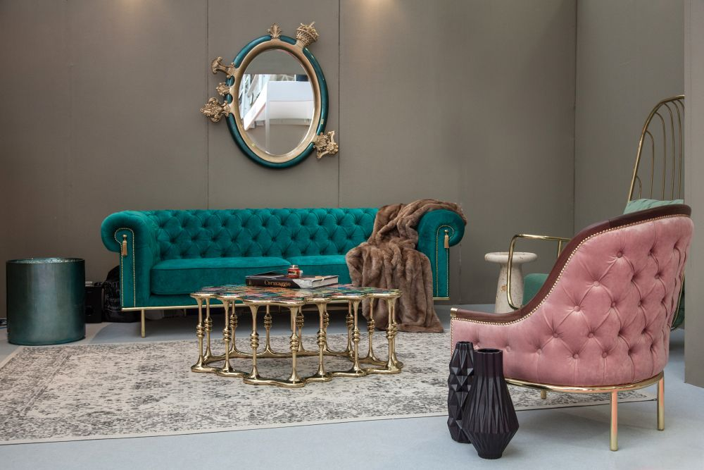 UK sofa with tufted pattern and gold legs