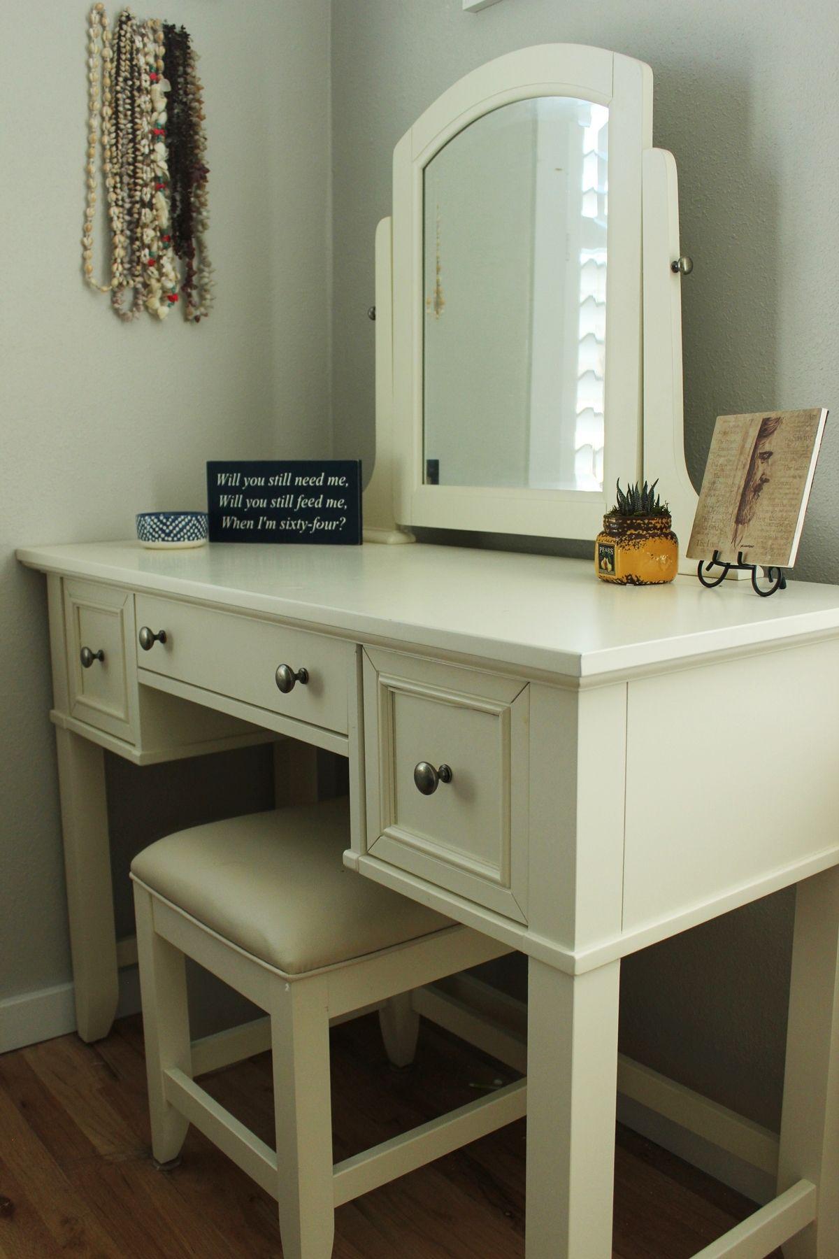 Bedroom with white vanity