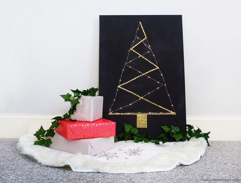 Black canvas and thumbtacks tree