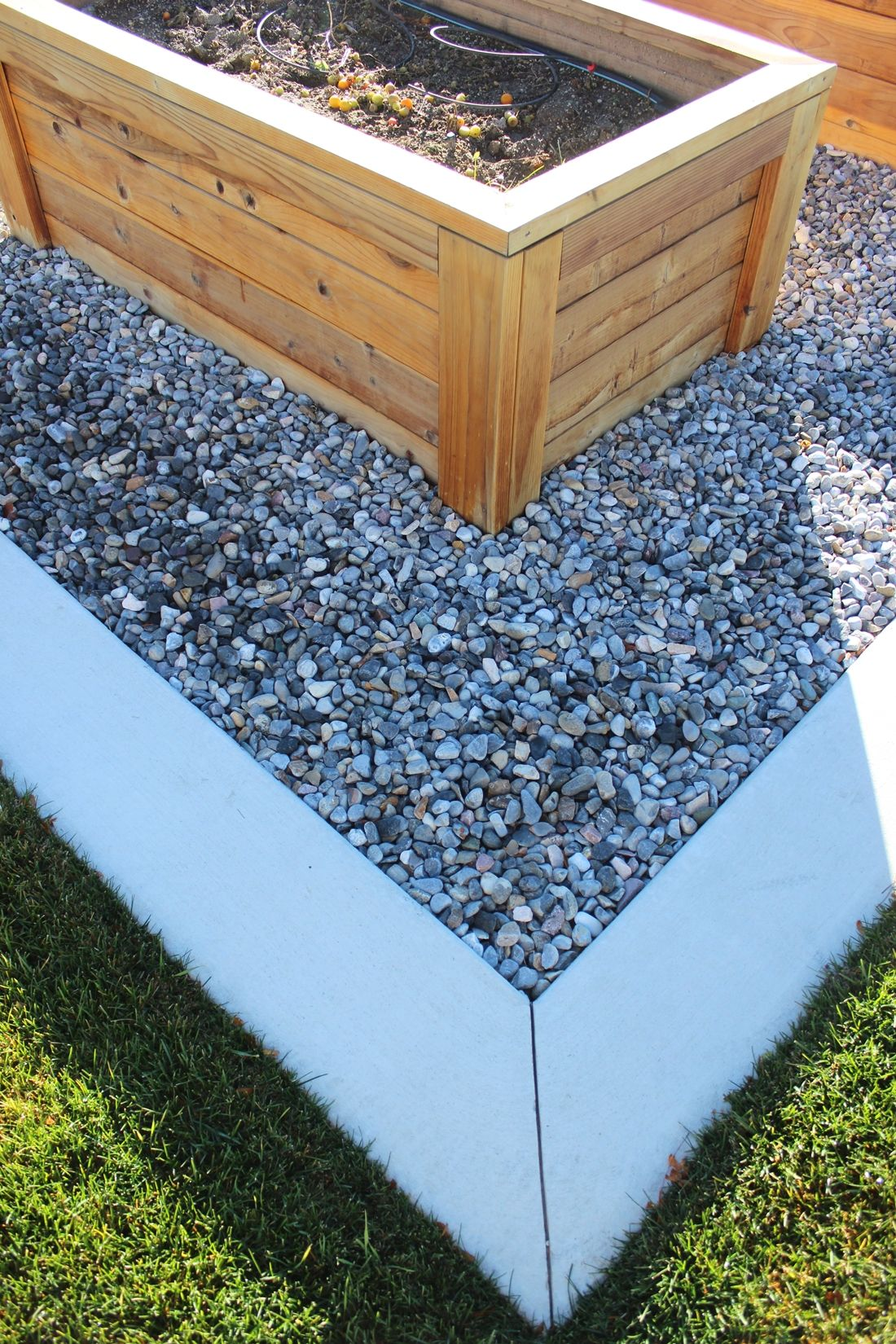 Curb Appeal - wood planters and river rocks