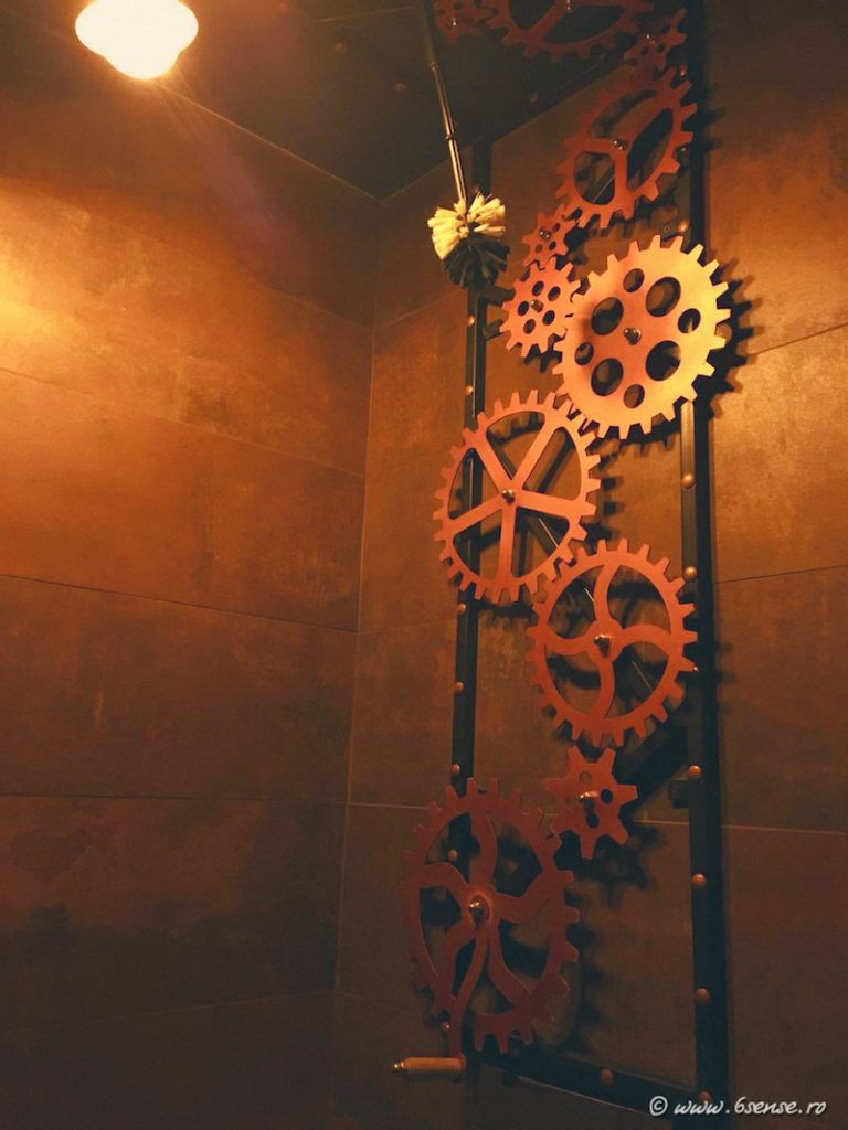 In here, the walls and ceilings are decorated with cog wheels