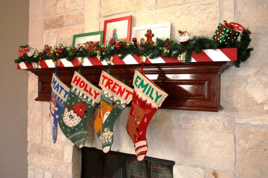 displaying stockings in front of the fireplace