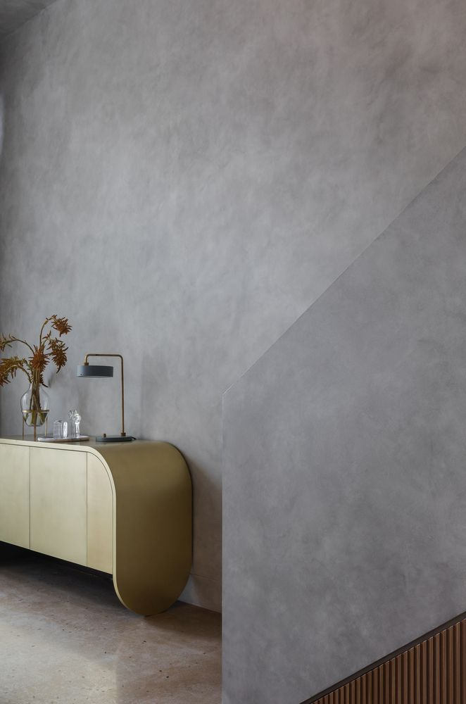 Delicate curves and lines soften the harsh aesthetic of the apartment giving it a unique vibe