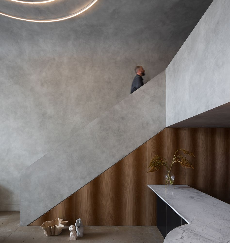 The raw concrete finish white defines almost every surface is balanced out by strategic wood accents