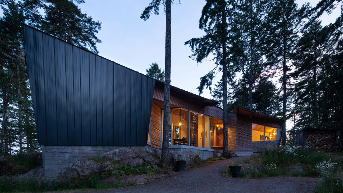 The house's angular design and unusual geometry actually help it blend in with trees