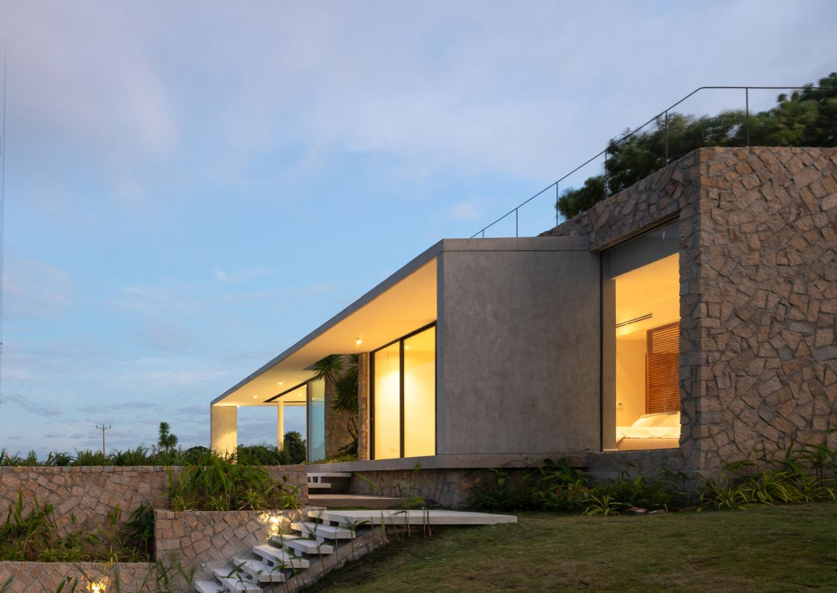 The thick stone walls and flat roof allow the house to more easily blend into the landscape