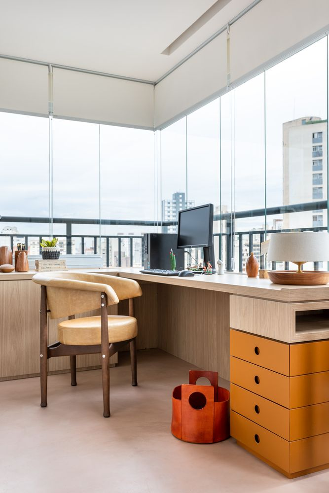 The workspace is one of the coolest areas of the apartment thanks to the panorama windows