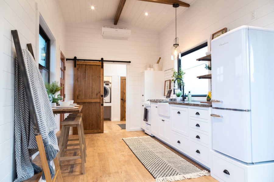 The kitchen is well-equipped and has generous storage as well as a farmhouse sink