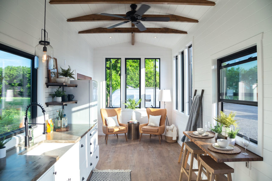 The interior has a farmhouse-style vibe and feels fresh bright and open