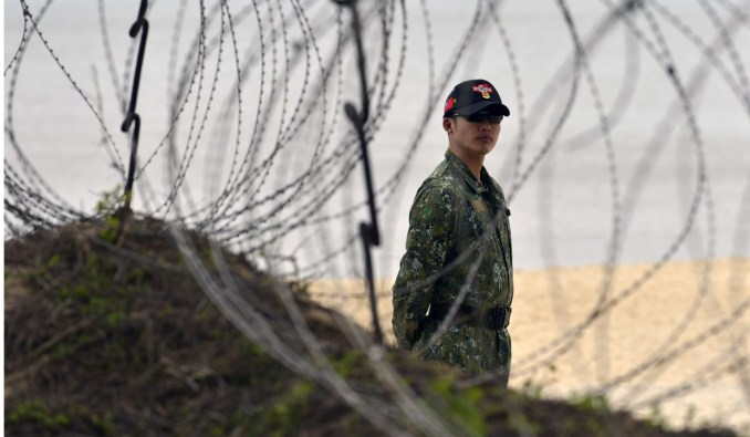 A Taiwan marine stands guard on Quemoy, which could be targeted in any effort by Beijing to reunify the self-ruled island. Photo: AFP