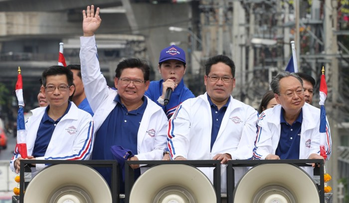Palang Pracharath leaders travel through the streets of Bangkok on a vehicle to thank Thais who came out to vote in the March election. Photo: EPA