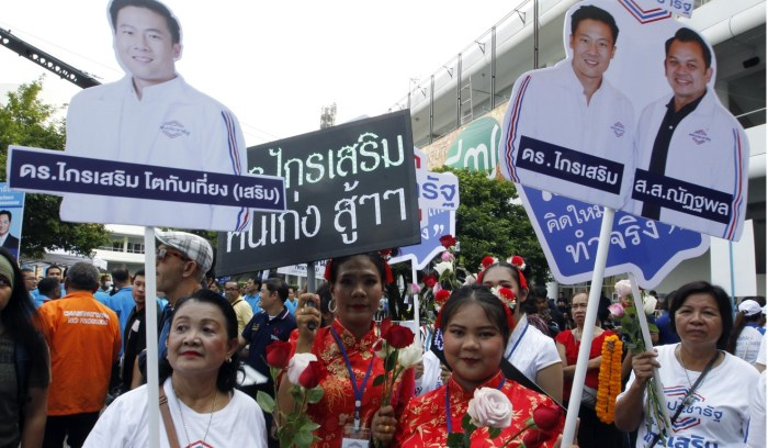 Supporters of pro-junta political party Palang Pracharath at a registration session for candidates in Bangkok before the election in March. Photo: EPA
