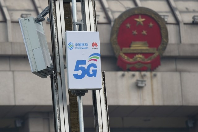 5G base station units with logos of China Mobile and Huawei Technologies are seen in front of the National People's Congress conference centre in Luoyang, Henan province, on February 27, 2019. Photo: Reuters