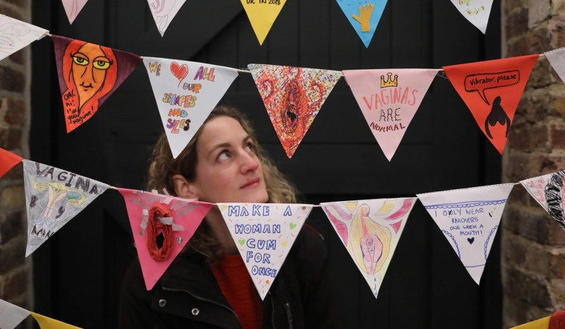 A visitor looks at a line of vagina-themed bunting at the new Vagina Museum in London on Thursday. Photo: AFP