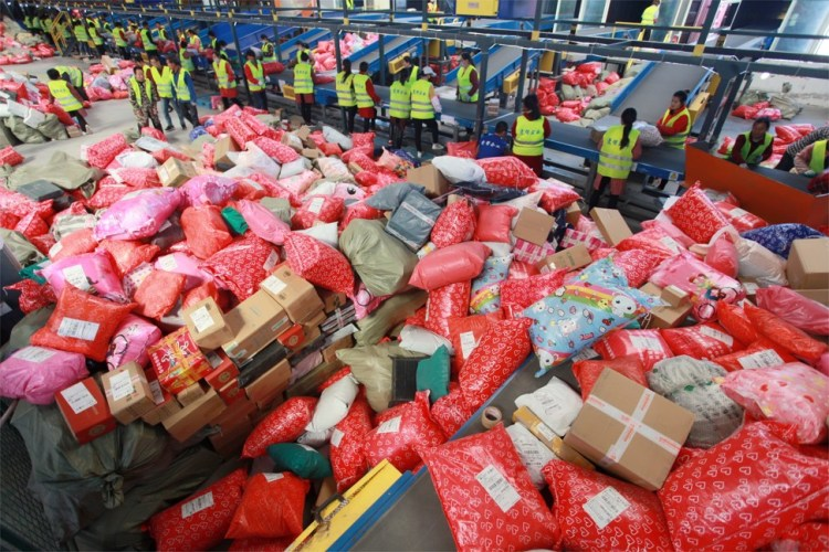 Workers sorting packages at the Yuqiao mail processing centre on Singles' Day in Yangzhou City in Jiangsu province on 11 November 2019. Photo: EPA-EFE
