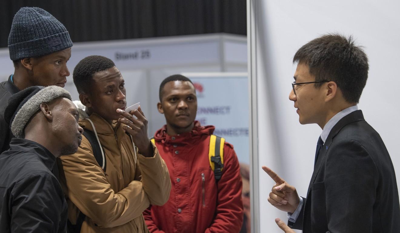 A staff member of a Chinese enterprise talks to job-seekers during a job fair in Johannesburg, South Africa earlier this month, when 60 Chinese enterprises operating in South Africa held a job fair. Photo: Xinhua